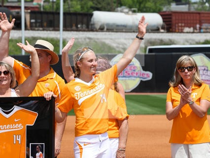 Tennessee senior Megan Geer (14) and her family wave to the crowd during Senior Day ceremonies on April 29, 2017 at Lee Stadium.