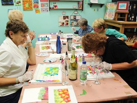 Attendees create their own glass art at KitscheCoo Art & Craft Shed, 5668 Broad St., Greendale.