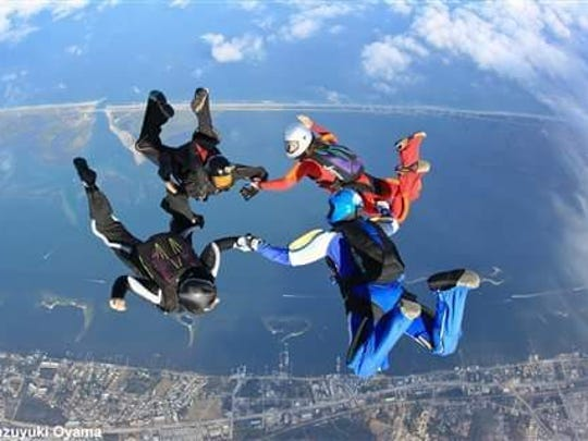 Kristal Ciamillo, lower left, in freefall skydive formation
