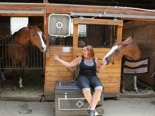 Lynn Kuropatkin with therapy horses Journey and Dakota