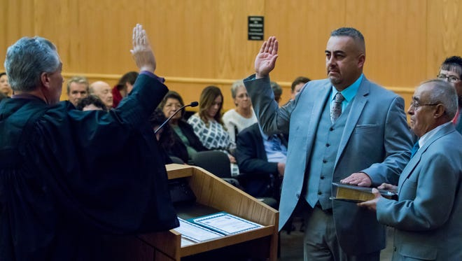 John L. Vasquez, the new District 5 county commisioner, takes part in a swearing in ceremony held at the county government center on Thursday, Dec. 29, 2016.