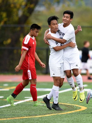 Old Tappan's Danny Yun #9 is congratulated by teammate JeeHo Yun  after Danny scored on a penalty kick during the first half against Bergen Catholic. Bergen Catholic played Old Tappan in the quarterfinals of the 2017 B.C.C.A. tournament in Mahwah on Sunday, October 15, 2017.