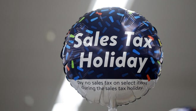 A balloon advertises Tennessee's tax-free weekend at the Knoxville Walmart Supercenter on Walbrook Drive in West Knoxville Friday, July 28, 2017.