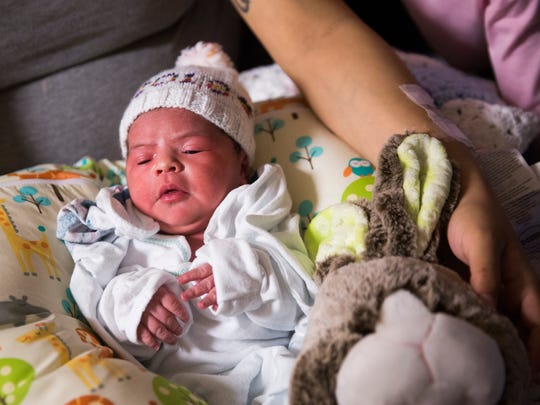 Alani Jordyn Gonzalez snuggles in her mother's lap on New Year's Day, Monday, Jan. 1, 2018, in The Birth Place at NCH North Naples Hospital. Alani Jordyn Gonzalez was born at 2:58 a.m. She was the first baby born in Collier County in 2018.