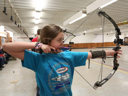 Serina Zelenka, of Wausau, gets ready to release an