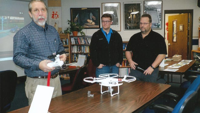 Northland Lutheran High School science teacher Rick Grundman talks about his science program, which includes 3-D printing, a drone and Rube Goldberg work, during a 2017 open house at the school in Kronenwetter.