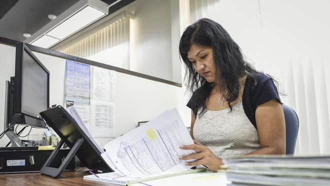 Susy Mae Santos, loan technician at Guam Housing Corporation, processes grant applications at the GHC office in Tamuning on Feb. 24. GHC offers up to a 4 percent grant, or $10,000, on a home purchase of under $250,000 to all first-time homeowner residents, regardless of income.