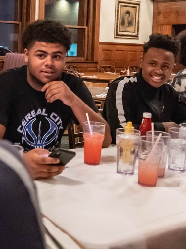 """Eric Hopkins, left, and Joshua Mann play football for Battle Creek Central. They were at Clara's on the River for """"Tuesdays with Coach Bess."""""""