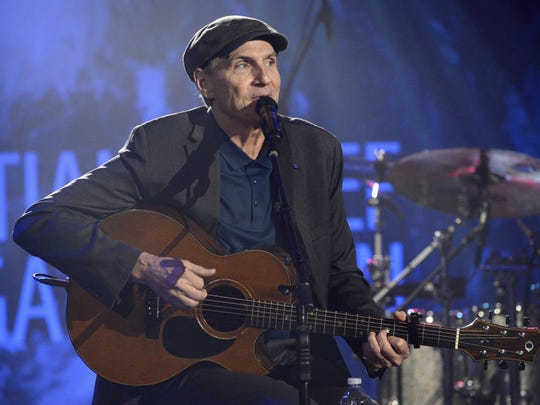 James Taylor performs at the 7th Annual Sean Penn &