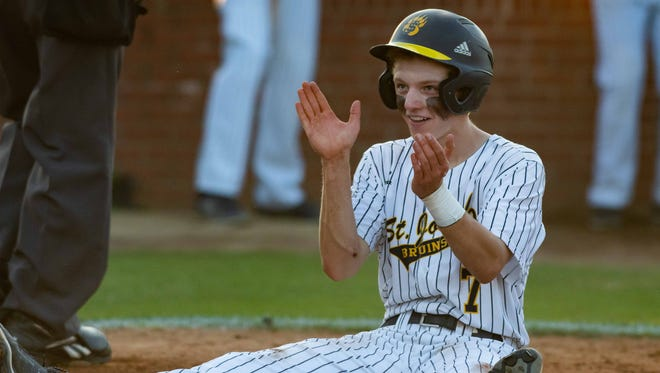 St. Joseph's Brady Johnson (7) celebrates scoring a run against Perry Central during the MHSAA 2A Playoff Baseball held at St. Joseph Catholic High School Friday May 10, 2018.(Bob Smith-For The Clarion Ledger)