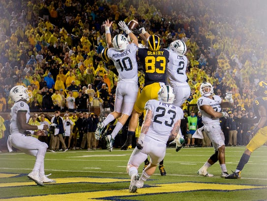 Michigan State defenders swarm a last-second Michigan pass into the end zone at the end of the Spartans' 14-10 win Oct. 7 at Michigan.