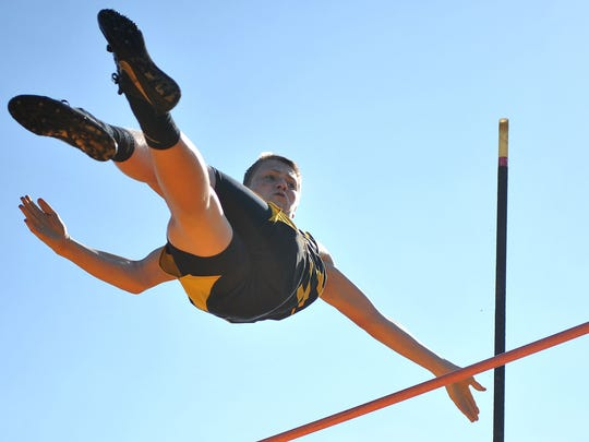 Colonel Crawford's Kaleb Landin flings himself over the pole vault Friday evening during the Colonel Crawford Bob Royer Relays.