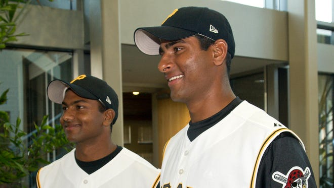 Rinku Singh, right, and Dinesh Patel, who didn't pick up a baseball until 2007, will see their story play out on the big screen.