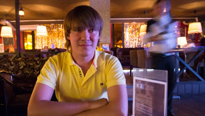 Andrey Ozerny, who wrote a letter to Sochi mayor Anatoly Pakhomov, telling him that he is not the only gay person in the city, sits inside Club Mayak, a gay club in Sochi, Russia.