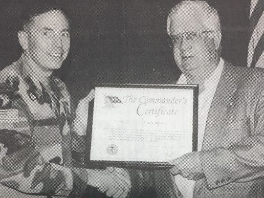 Major General David H. Petraeus, Commanding General of Fort Campbell, presented the Commander's Certificate to Donnie Greenwell of Uncle Mark's Popcorn in Waverly for contributing flavored popcorn to soldiers returning from the war in Iraq and Afghanistan in May 2004.