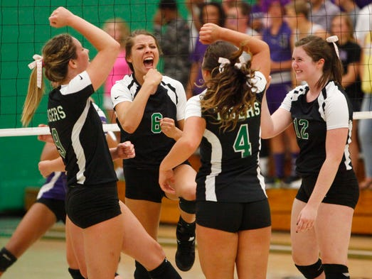 The Yorktown volleyball team celebrates a victory during the first set of the match on Thursday evening against Central at Yorktown High School. Yorktown took the game 3-2.
