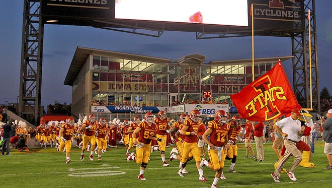 Iowa State head coach Paul Rhoads lead his team onto the field before the game against Baylor at Jack Trice Stadium in Ames on Saturday night Sept. 27, 2014.
