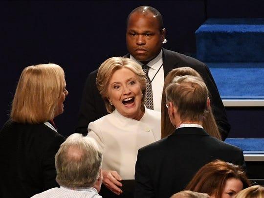 Hewlett Packard CEO Meg Whitman, left, is a bundler for Hillary Clinton, center.