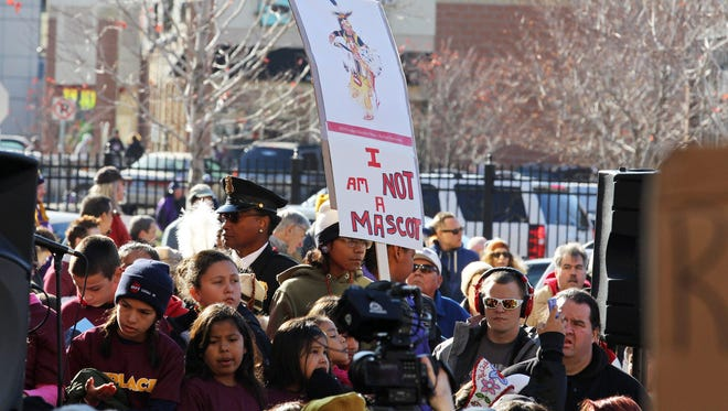 Nov 2, 2014; Minneapolis, MN, USA; A detailed view of a sign during a protest against Washington Redskins name and imagery prior to a game against the Minnesota Vikings at TCF Bank Stadium.