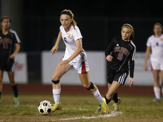 Leon sophomore Maddie Powell dribbles the ball past Columbia defenders during their District 2-4A semifinal game at Chiles High School on Wednesday. Powell scored two goals in a 4-0 win.