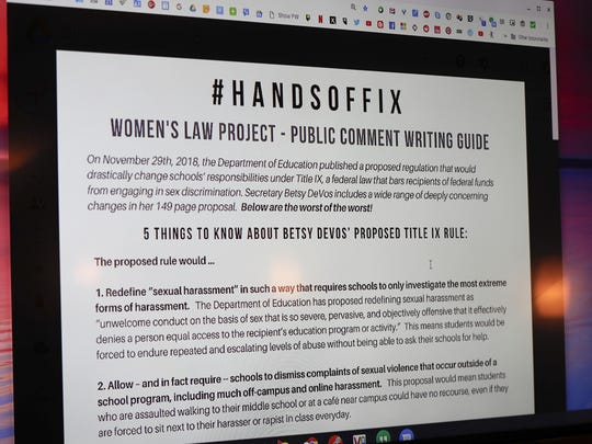 In this Jan. 23, 2019, file photo, a screen with information from the Women's Law Project shows information on some of the proposed changes to the implementation of Title IX as it pertains to the sexual abuse regulations in education at the NOW monthly meeting in Monaca, Pa.