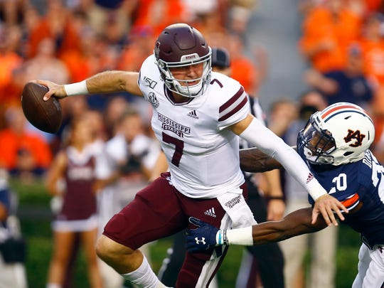 Mississippi State quarterback Tommy Stevens (7) is sacked by Auburn defensive back Jeremiah Dinson (20) during the first half of an NCAA college football game, Saturday, Sept. 28, 2019, in Auburn, Ala. (AP Photo/Butch Dill)