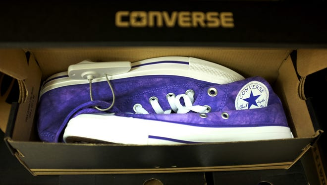 Converse shoes are seen in a store on October 14, 2014 in Miami, Florida.