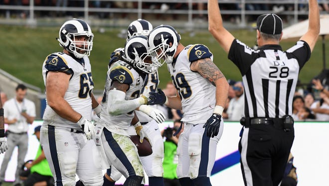 Rams running back Todd Gurley, center, has 13 touchdowns -- 10 rushing, three receiving -- this season.
