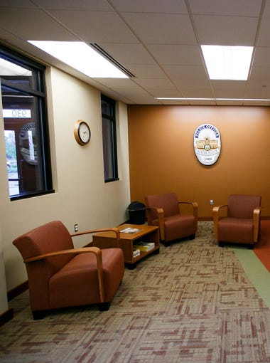 """The lobby of the Keizer Police Department was designed to feel more warm and inviting than the department's previous space, which was in a converted elementary school. """"We didn't want an institution feel with metal and steel,"""" Deputy Chief Jeffery Kuhns said."""