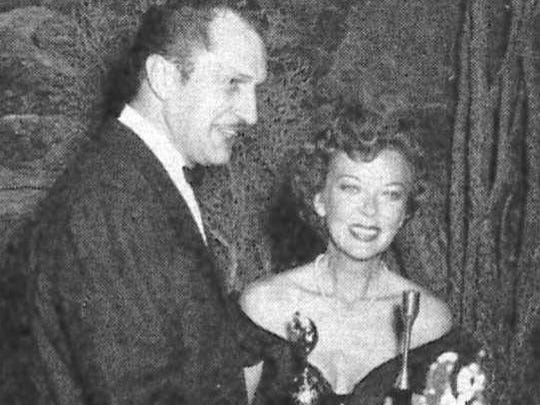 Vincent Price presents Ida Lupino with her Henrietta for Hollywood woman of the year.