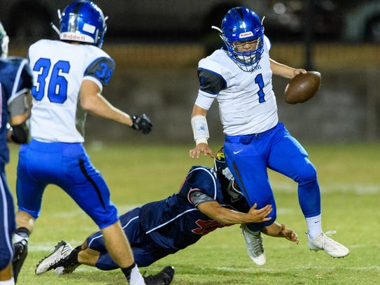 Bagdad's Israel Loveall (No. 1) set the state's career
