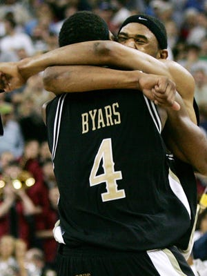 Vanderbilt's Shan Foster (32) hugs teammate Derrick Byars (4) after the Commodores beat the Cougars in double overtime to advance to the Sweet 16 in the NCAA Tournament.
