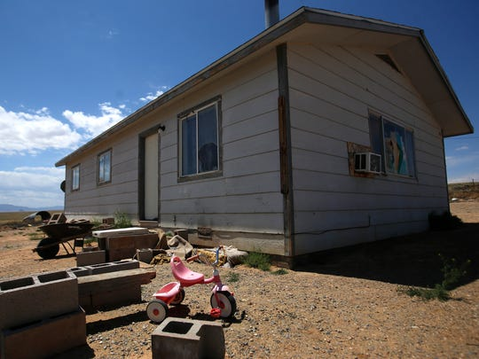 Tom Begaye Jr.'s home is pictured on Thursday off U.S. Highway 64 in Gadiiahi west of Shiprock. Begaye has been accused of kidnapping and murdering 11-year-old Ashlynne Mike.