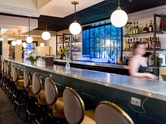 The old wooden bar of the former St. Cece's Pub space has been replaced with a more contemporary zinc-topped one at Lady of the House, which opens to the public in Corktown September 20.
