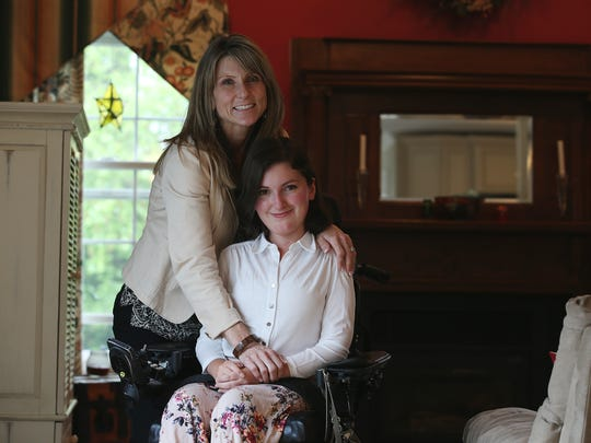 Anna Landre, former Freehold Township valedictorian and a Georgtown University student who is fighting for the rights of disabled workers in New Jersey, poses with her mother, Laura Landre
