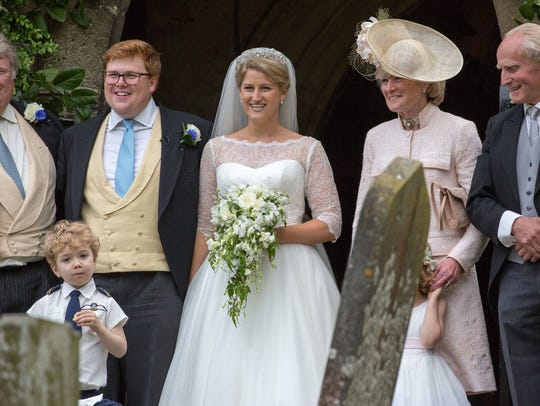 George Woodhouse and Celia McCorquodale (center) and her parents, Lady Sarah McCorquodale and Neil McCorquodale (right) at Celia's wedding to Woodhouse in Stoke Rochford, England on June 16, 2018.