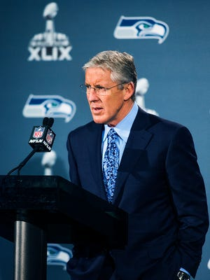 Seattle Seahawks coach Pete Carroll answers questions from the media during a press conference at the Arizona Grand Resort after arriving from Seattle, Sunday, Jan. 25, 2015. The Seahawks play the New England Patriots in Super Bowl 49 on Feb. 1, 2015.