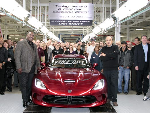 Chrysler Group Chairman and CEO Sergio Marchionne, right, and Vice President of the UAW Chrysler Department General Holiefield , along with members of the Viper team, celebrate the start of production of the 2013 SRT Viper