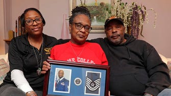 Carmen Adams (from left), her mother Gwen Adams and father Johnnie Adams hold a portrait of her brother Corey Adams, an Afghanistan veteran who suffered from PTSD and disappeared last year. Eighteen days later his body was found in a Milwaukee park. Because of Adams' case, state legislators are working to get a Green Alert for missing and vulnerable veterans just like the Amber and Silver alerts.