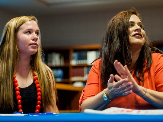 Montgomery Catholic Preparatory student Michaelyn Foster sits with her mother Chastity Foster while signing to play softball at Auburn Montgomery during a ceremony at the Catholic campus in Montgomery, Ala., on Tuesday November 15, 2016.