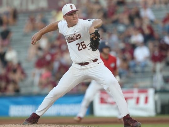 FSU's Cole Sands pitches against Samford during their