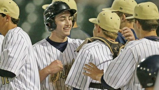 Cathedral senior Jared Poland (center) was named City Player of the Year.