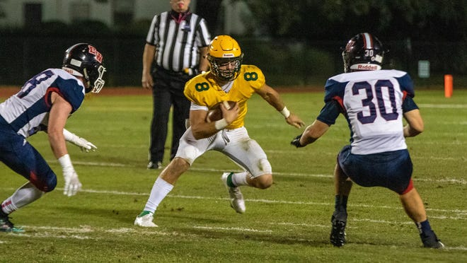 Savannah Country Day quarterback Barry Kleinpeter (8) eludes Deerfield-Windsor defensive players and gains a first down on Friday night at Savannah Country Day.