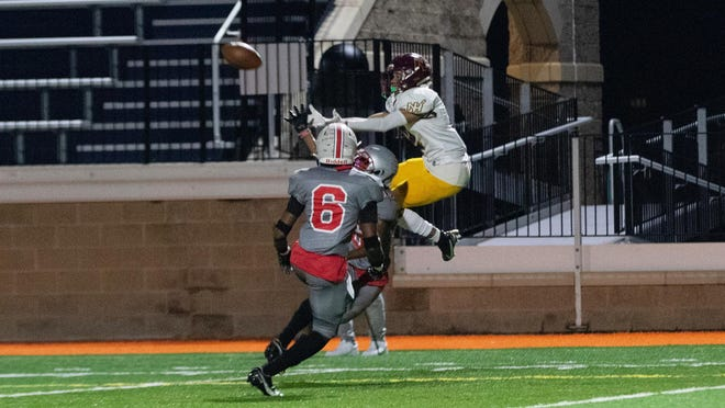 New Hampstead's Trey Speaks makes a nice catch to score a 20-yard touchdown against Jenkins on Friday night at Memorial Stadium. New Hampstead won 44-20.