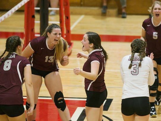 First Baptist Academy players celebrate scoring a point