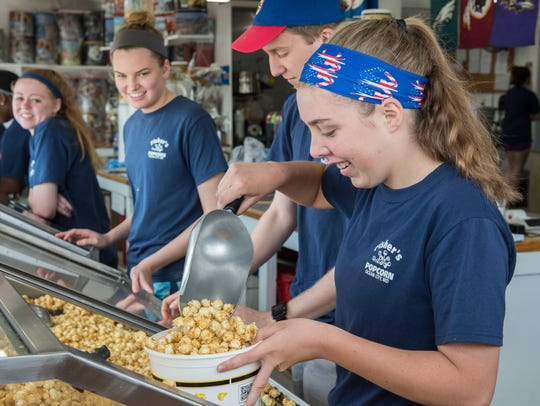 Hayley Short, of Salisbury, fills a container with