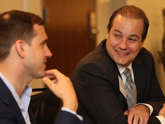 Stefan Krasowski, left, and Charles Achoa Jr., discuss