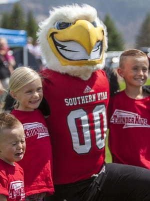 Children pose for a photo with Thor during SUU's Watermelon Bust on Saturday, Sept. 12, 2016.