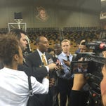 New head coach Johnny Dawkins addresses media at the CFE Arena on Thursday.