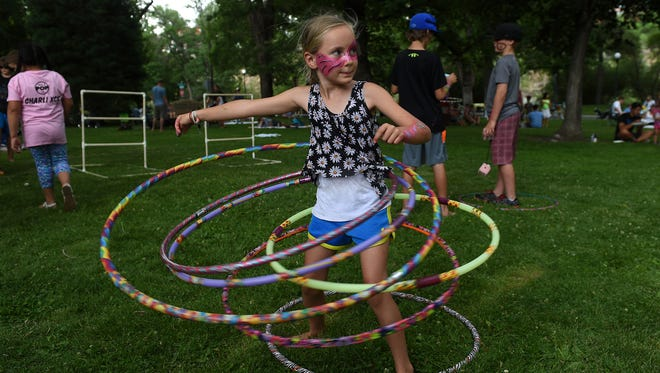Eight year old Aurora Lubra hula hoops during Artown's 20th anniversary opening night celebration at McKinley Arts and Culture Center in Reno on July 1, 2015.
